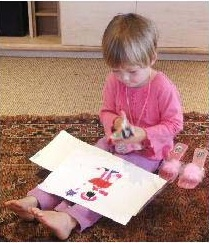 Preschool child drawing with stencils