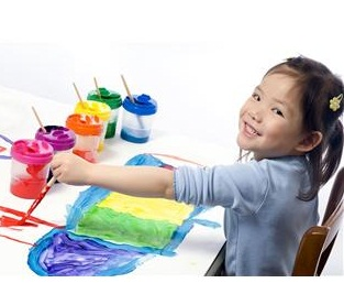 Preschool girl playing with paint