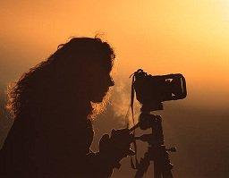 woman setting up camera and tripod